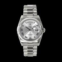 Rolex Men's White Gold Day-Date - President Rhodium Roman Dial - 18K Fluted Bezel - Presidential Bracelet 36 MM 118239