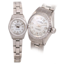 Rolex Ladies Oyster Perpetual Stainless Steel - Custom Mother of Pearl Diamond Dial And Diamond Bezel On An Oyster Folded Band